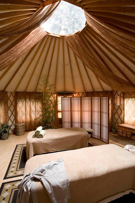 Awesome interior in a YURT, love the open floor plan in a yurt. ;) And ALL those Windows!! ;)