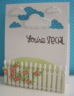 luv the use of the cloud die cuts and then backing the negative space they left with polka dot blue...twining the flowering vine around the die cut fence too...amazing card!!!