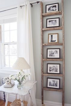 Gratefully Vintage- Antique Ladder Decor Create a beautifully unique look in your home using an old ladder. It's a great way to frame out and display your family photos. This would look lovely in my living room.