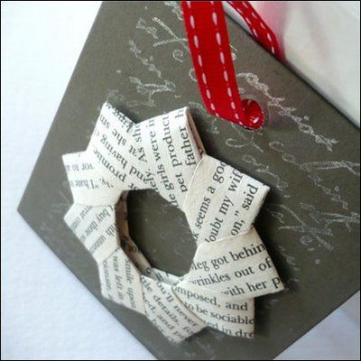 """Origami Wreath made from old book bages.  (Ornament with family picture tucked in the middle.)  Need 8 strips 1 1/2"""" x 3""""."""
