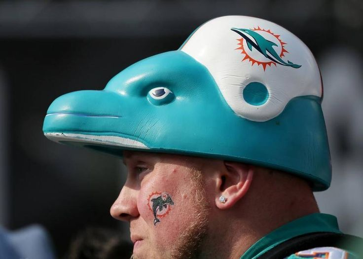 A Dolphins fan stands on Wembley Way as he arrives for the NFL football game between the New York Jets and the Miami Dolphins and at Wembley stadium in London, Sunday, Oct. 4, 2015.
