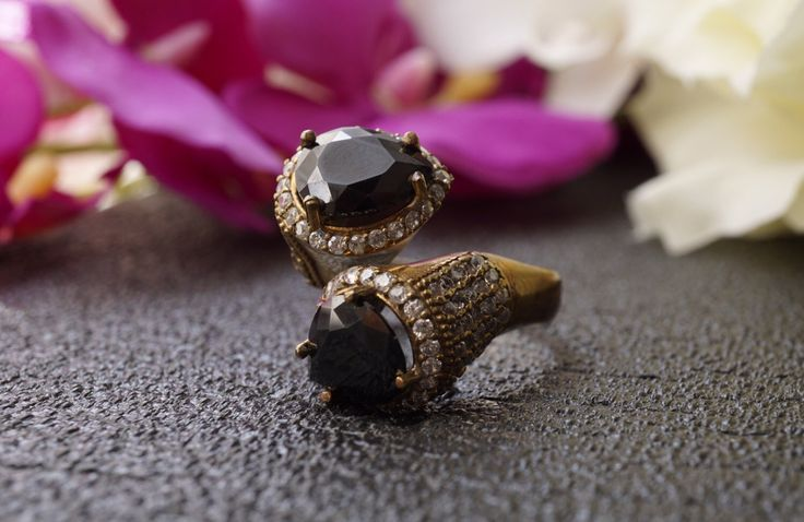 A personal favorite from my Etsy shop https://www.etsy.com/listing/474269302/drop-onyx-silver-ringantique
