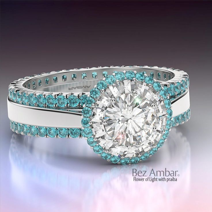 Stunning Wedding Rings A Paraiba Tourmaline wedding set Flower of Light with round diamond surrounded by a double halo of white Blaze