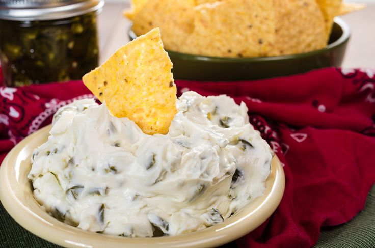 """It's a jalapeno dip that is """"Sweet"""" & """"Hot"""" and you just can not stop eating it. There are only two ingredients in the dip but you need to have a jar of homemade """"Cowboy Candy"""" on hand to make..."""