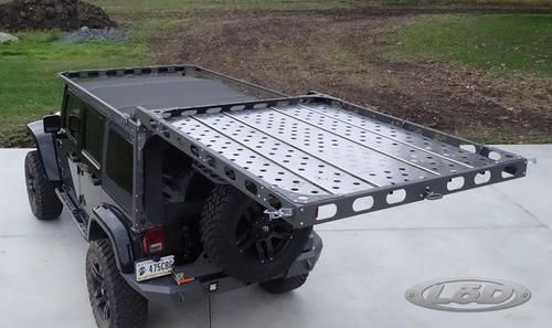 Gain easy access to your soft top, freedom panels or rooftop cargo in your Jeep Wrangler JK 4 Door with LOD Offroad's Easy Access Roof Rack today!