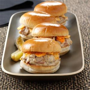 Touchdown Brat Sliders Recipe.  I don't like beer, but I bet these would be a big hit, and easy to make for your next party....Superbowl Sunday maybe?