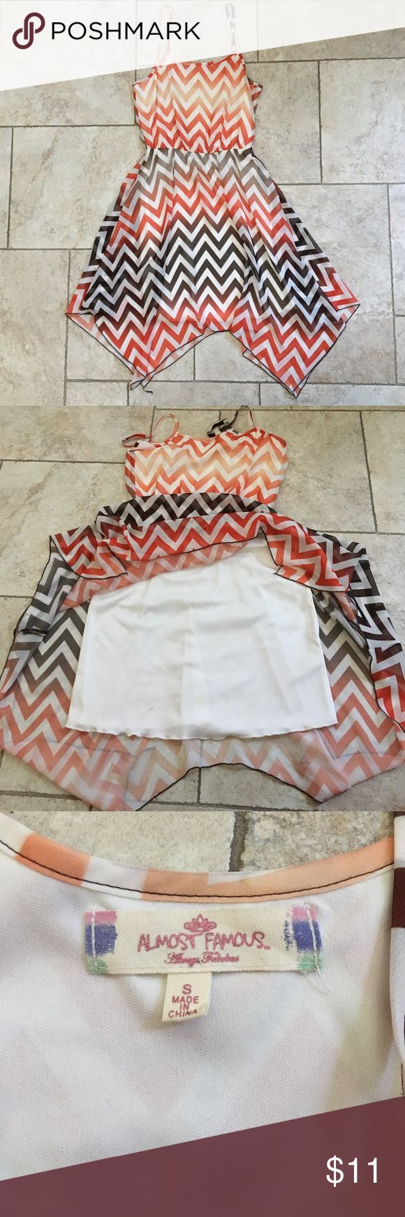 Multicolored Chevron Print Dress Size SMALL Beautiful flowing dress. Has white liner underneath that has one small stain. Not visible when then dress pattern is down. Adjustable straps. Dresses