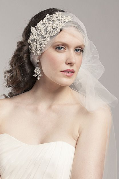 Mackenzie, this couture tulle hair wrap will be the talk of the wedding! Featuring a beautiful crystal embroidered motif that will be sure to make a statement!