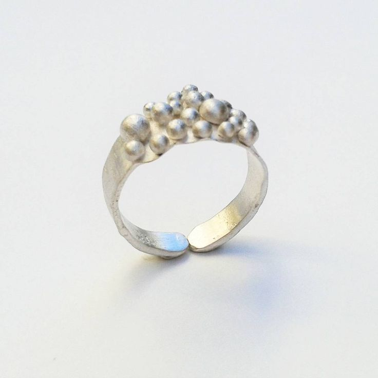 Fused sterling silver ring with silver bubbles.