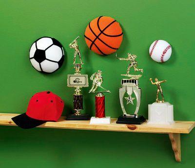 "Sports Ball Decor  •Styrofoam® Balls, 7"" and 4""  •Creatology™ Felt Sheets- Orange, White and Black  •Creatology™ Chenille Stems- Black  •Craft Knife  •Scissors  •Low Heat Glue Gun"