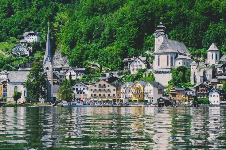 Can you recognize this famous European village from where we stand? It has the cutest most colorful houses built into the mountain and some almost touching the lake. Swans are used to giving a pose while tourists paddle their way in the long wooden boats