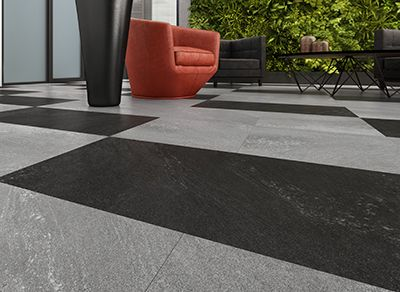 Mirra Stone falls under the category of luxury vinyl tiles characterized by strength and resiliency.