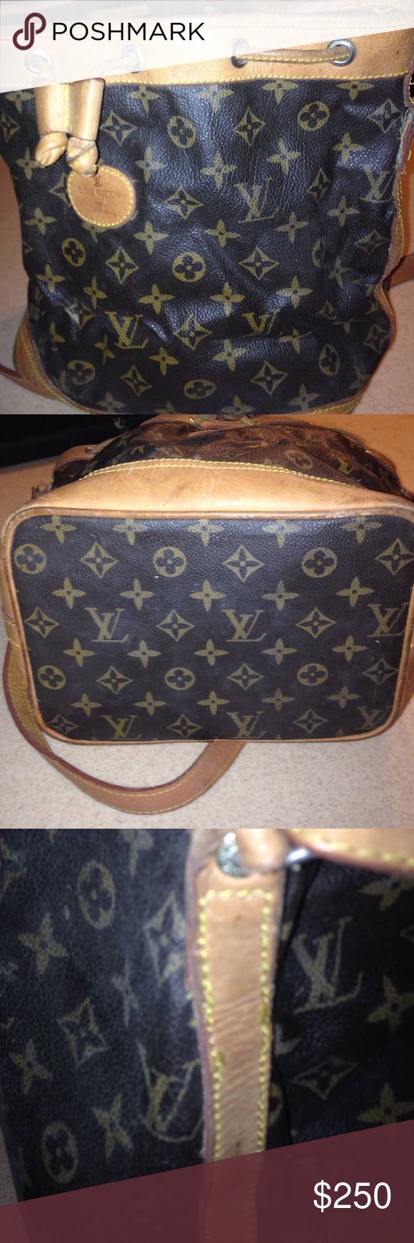 Vintage authentic Louis Vuitton bucket bag Vintage authentic Louis Vuitton bucket bag   Needs tax. I had it repaired and the guy did not do a good job. Leather needs conditioning.  I do not have time to give the bag the love it needs.  Please look at bag pictures carefully. Lining is felt and in tact. Great bag for the Louis lover that wants a great deal. If you fix it up you will get $500 for it.  The bag was left to dry put. Louis Vuitton Bags