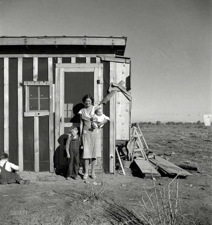 "December 1935. ""Resettled at Bosque Farms project in New Mexico. Family of four from Taos Junction shows temporary dwelling."" Medium-format negative by Dorothea Lange for the Resettlement Administration."
