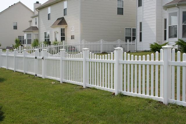 White vinyl scalloped picket fence