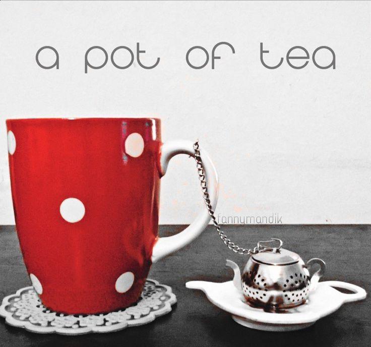 Teapot tea container and red polkadot mug.