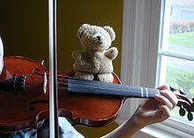 "Exercise for good violin position Some children have a hard time to keep themselves upright while they are playing and tend to ""collapse"". In that case, give Mr. Bear or any other stuffed friend a ride on the instrument. The child wouldn't want him to fall down. This exercise can also be helpful if your child's bow has a habit of wandering off the Kreisler Highway towards the fingerboard."