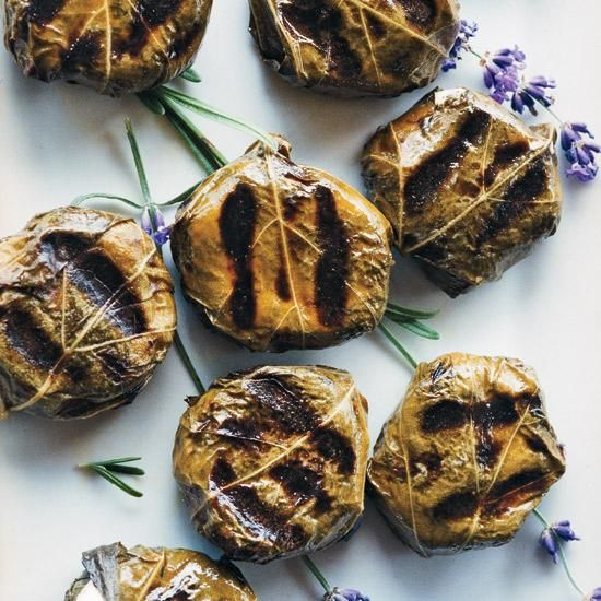 Goat-Cheese-Stuffed Grape Leaves   Inspired by Turkey's stuffed grape leaves, Mehmet Gürs ingeniously wraps goat cheese in the briny leaves then quickly grills the little packages so the cheese melts.