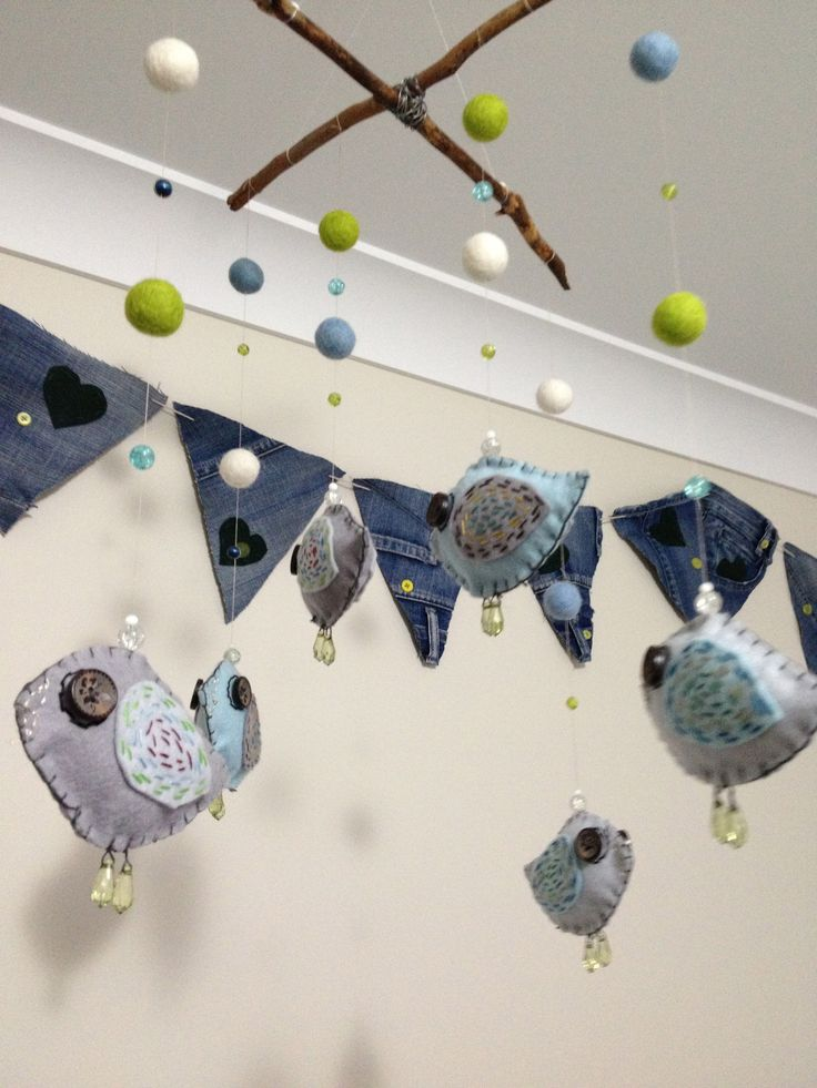 Bunting made from old jeans and a mobile of sticks and felt.