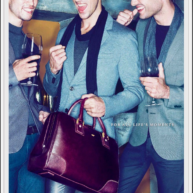 Braun Buffel. Not sure if that's the kind of man-bag I wanna be seen carrying around though.