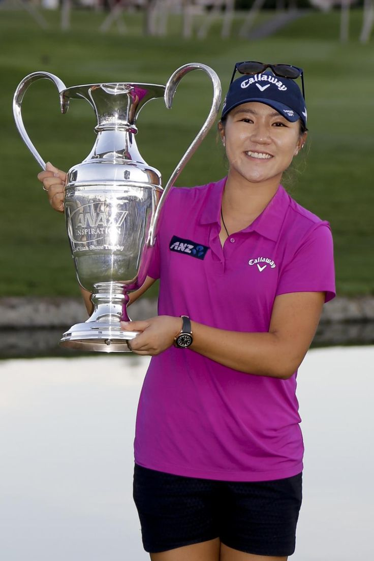 Lydia Ko, of New Zealand, poses with the trophy after winning the LPGA Tour ANA Inspiration golf tournament at Mission Hills Country Club, Sunday, April 3, 2016, in Rancho Mirage, Calif. (AP Photo/Gregory Bull)