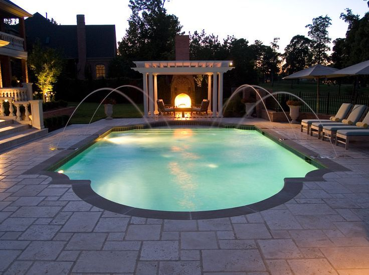 Night View Of Roman Style Swimming Pool With Deck Jets Swimming Pool Designs Swimming Pools Pool Designs