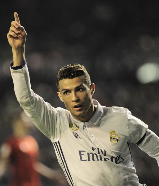 Real Madrid's Portuguese forward Cristiano Ronaldo celebrates after scoring his team's first goal during the Spanish league football match CA Osasuna vs Real Madrid CF at El Sadar stadium in Pamplona on February 11, 2017. / AFP / ANDER GILLENEA