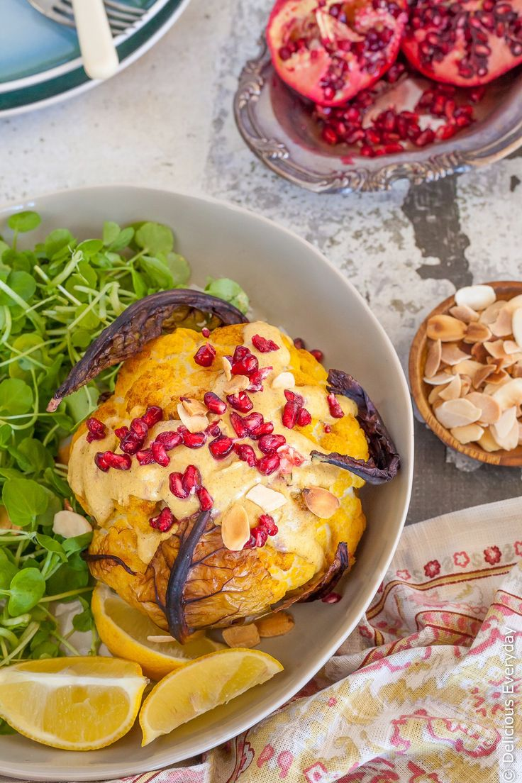 This Whole Roasted Cauliflower Head recipe is a wonderful way to enjoy cauliflower as baking it really amps up the flavour. Bathed in an nutty Tahini Sauce with gorgeously fragrant ras el hanout topped with pomegranate seeds and toasted almonds its a far cry from the cauliflower you pushed around your plate growing up!