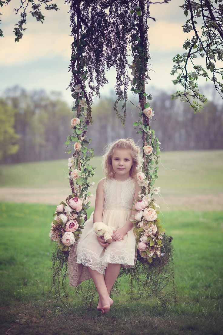 Wooden swing, flowers, and a beautiful little girl.  Children photography