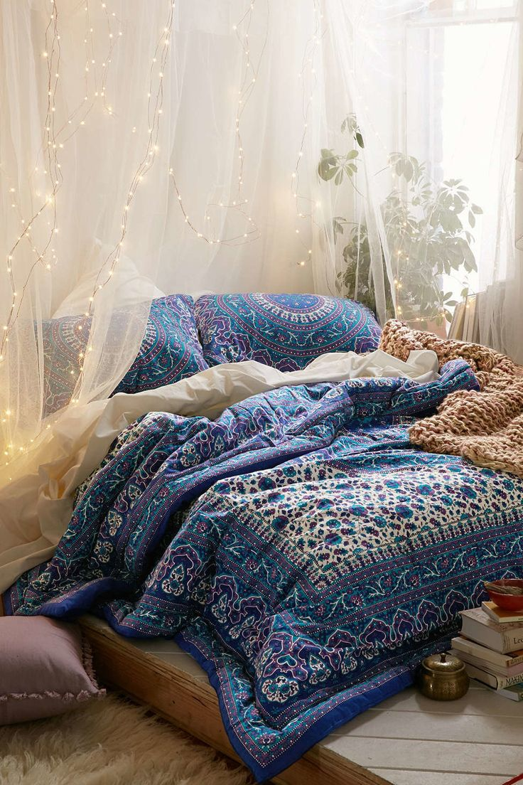 If you have a canopy surrounding your bed, try draping string lights down along the sheer curtains.
