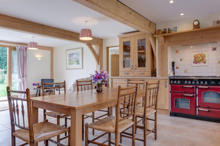 Beautiful oak frame kitchen from Welsh Oak Frame with exposed oak beams and joists. www.welshoakframe.com The post and beam style of oak frame gives the kitchen a more contemporary look. #oakframe #kitchenideas #exposedbeams #modernkitchen