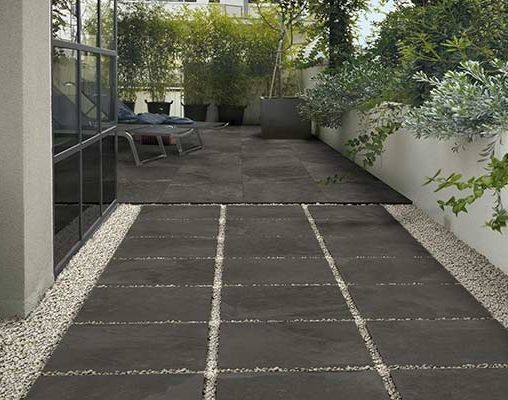 These 20 mm heavy-duty pavers from Landmark Ceramics USA can easily dry-lay on sand, gravel, or grass to create a patio or stepping-stones between outdoor rooms. It's anti-slip, frost-proof, and you can take it with you when you move—a perk unheard of for most tile installations. Shown here: the Frontier20 line of gres porcelain stoneware  in Vintage Slab.  ~ Great pin! For Oahu architectural design visit http://ownerbuiltdesign.com