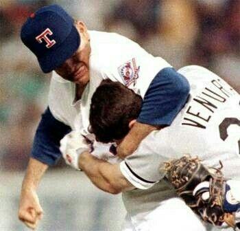 Robin Ventura getting dealt with by Nolan Ryan.