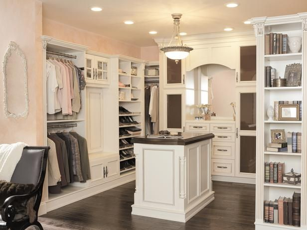 phenomenal master closet with built-in cabinets from Wellborn Cabinet via Coast Design Kitchen & Bath