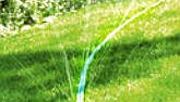 "Make your own sprinkler hose from old garden hose by piercing holes in a pattern to direct the flow where you want it. Use a hot needle to pierce the hose, and be sure to crimp the end of the hose line.  Use ""Y"" connectors to add more lines. These are available in plastic or brass. Lay the hose on the ground and work it between plantings and along rows as desired. Be sure the hose ends are closed."