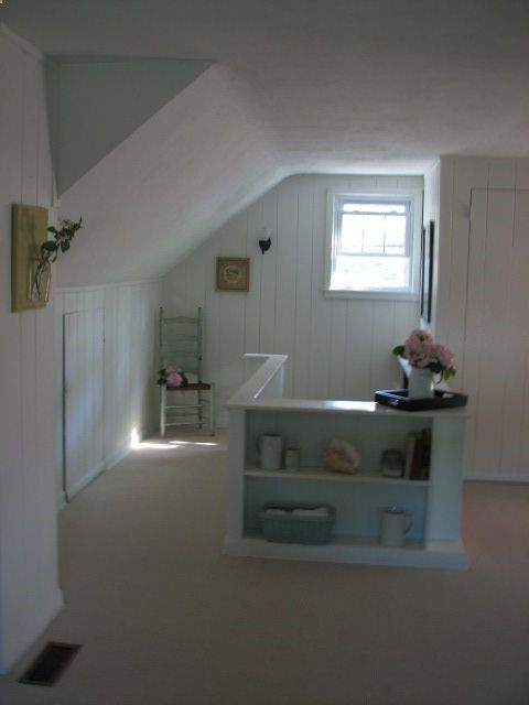 upstairs attic room, like the bookshelf and stair entrance.