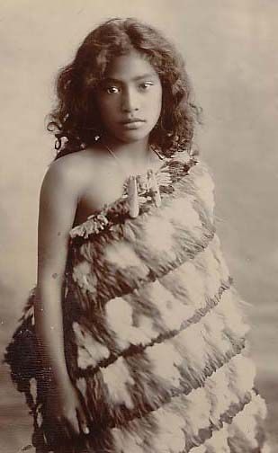 Maori girl in feather cloak and pounamu, c 1900