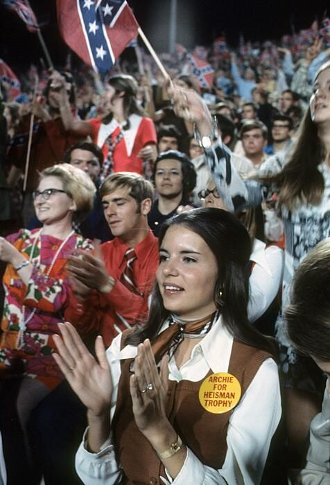 Olivia Manning At 1970 Ole Miss Game. This is such a beautiful picture to me. Love the confederate flags in the background.