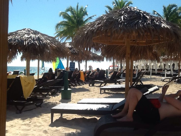 Lots of thatched huts at Memories beach, keep u and your drinks cool between splashes in the surf :)