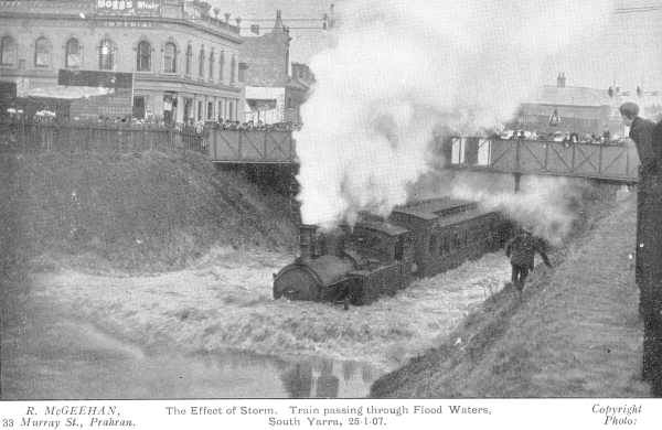A train passes through flood waters under Chapel Street, South Yarra, in January 1907. The Imperial Hotel, seen on the left, is still in operation, on the corner of Palermo Street.