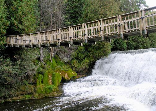 Wooden bridge over waterfall