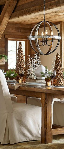 Christmas Dining- This website has beautiful rustic Christmas decorating ideas. Okay, I just really like the whole thing. The lights, the beams across the ceiling. the table, everything.