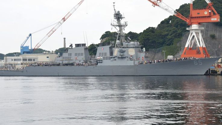 BBC - A US warship suffers slight damage after being struck by a Japanese tug.