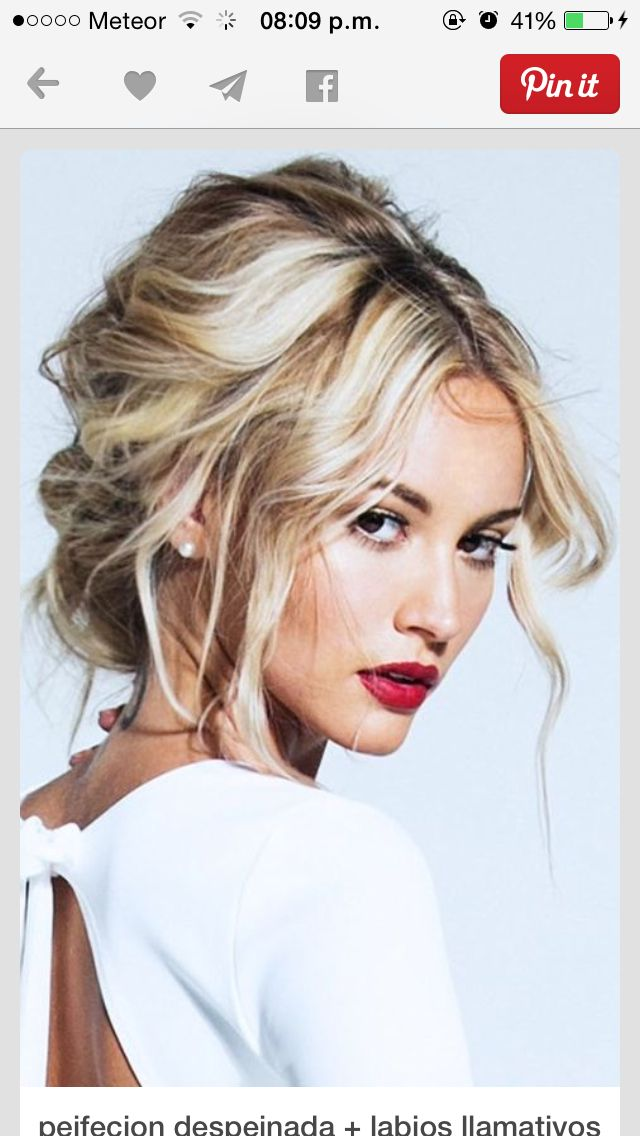 Messy updo blonde wavy middle parting