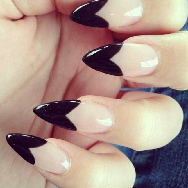 Nude and black heart stilleto nails.