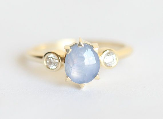Dreamy star sapphire ring with 2 diamonds on each side. If you want something special for your lady this is the right ring for her:) This ring is ONE