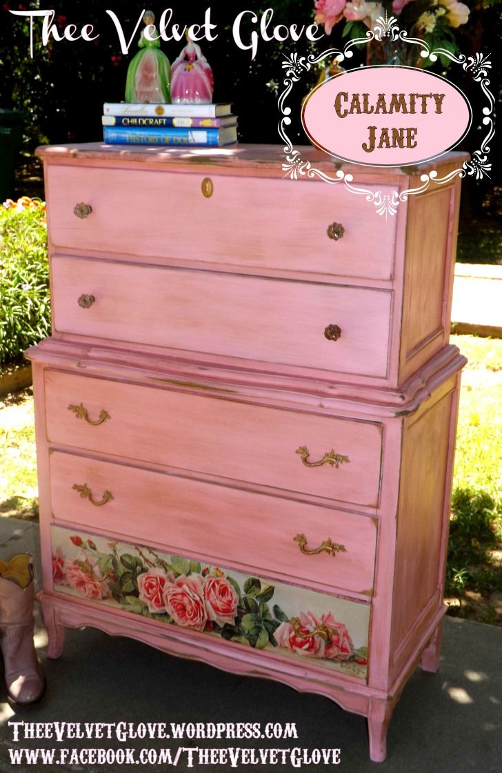 Distressed Pink Tallboy Chest of Drawers. Part Hollywood part Honkeytonk. Painted in Pink then Grunged-Up and Antiqued with a Homespun Deep Whiskey Hue Glaze and Distressed just like American Frontierswoman Calamity Jane. Heavy Glass Knobs and Antique Glazed Gold Drawer Pulls. Bottom drawer is covered in an artistic shabby rose print. Painted Furniture / makeover / redo