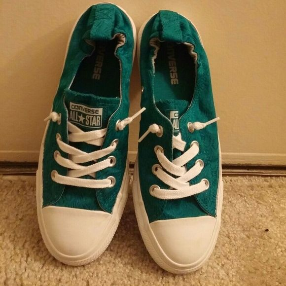 Turquoise Converse slip-ons Lightly used slip-on covers, they have only been worn a couple time. I just have to many shoes. Converse Shoes Sneakers