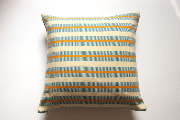 These divine cushions are a collaborative effort by designers in the UK and their head weaver in Bolgatanga, northern Ghana. Inspired by tribal patterns, the Fra Fra cushion brings a hint of Africa and texture to the range. Using poly-cotton yarn sourced locally to create the front panel and fair trade organic linen for the back panel.  Discover more here: http://www.pearlgrace.co.uk/pearlgrace/handwoven-cushions