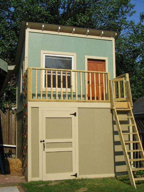 Shed with playhouse on top; like the rock climbing wall on the side; would fix that scary ladder somehow